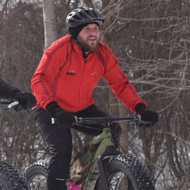 Here in the bikepic, a cyclistfinds winter bike riding can be fun when commuting in the Anoka, County Area of the Twin Cities Metro.