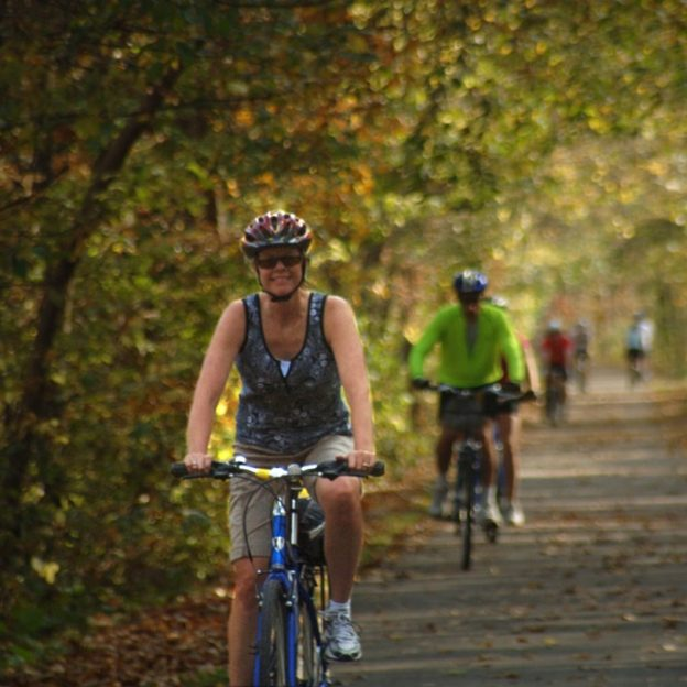 Bike riders in Mankato enjoy the fall flora and fauna of the Sakatah Singing Hills State Trail.