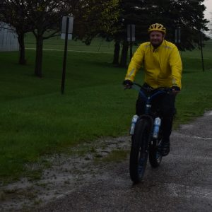 Fat bike rider having fun riding in the rain, near Stillwater MN.