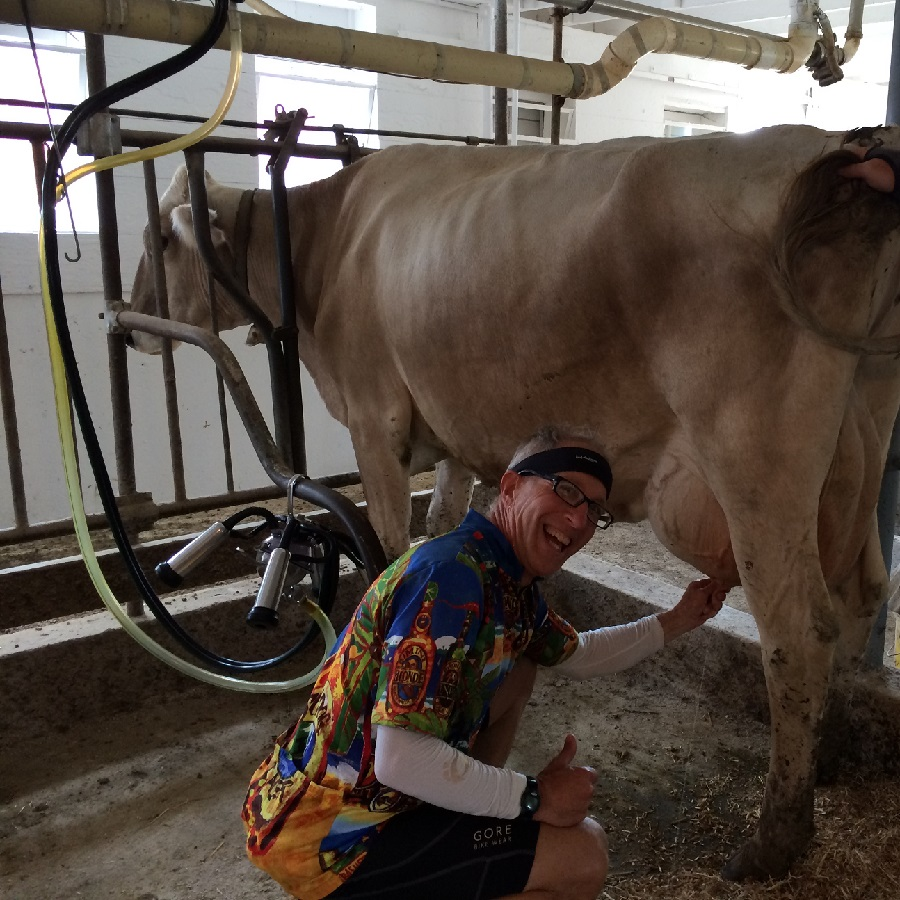 When he isn't biking this cyclist is eager for a new experience like milking a cow, which he did on the 2015 Swiss Cheese & Spotted Cow Bicycle Tour.