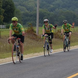 Fun in Minnesota's Bluff Country. Here Scott Larson, Mary Derks and friend ride through the Root River Valley.