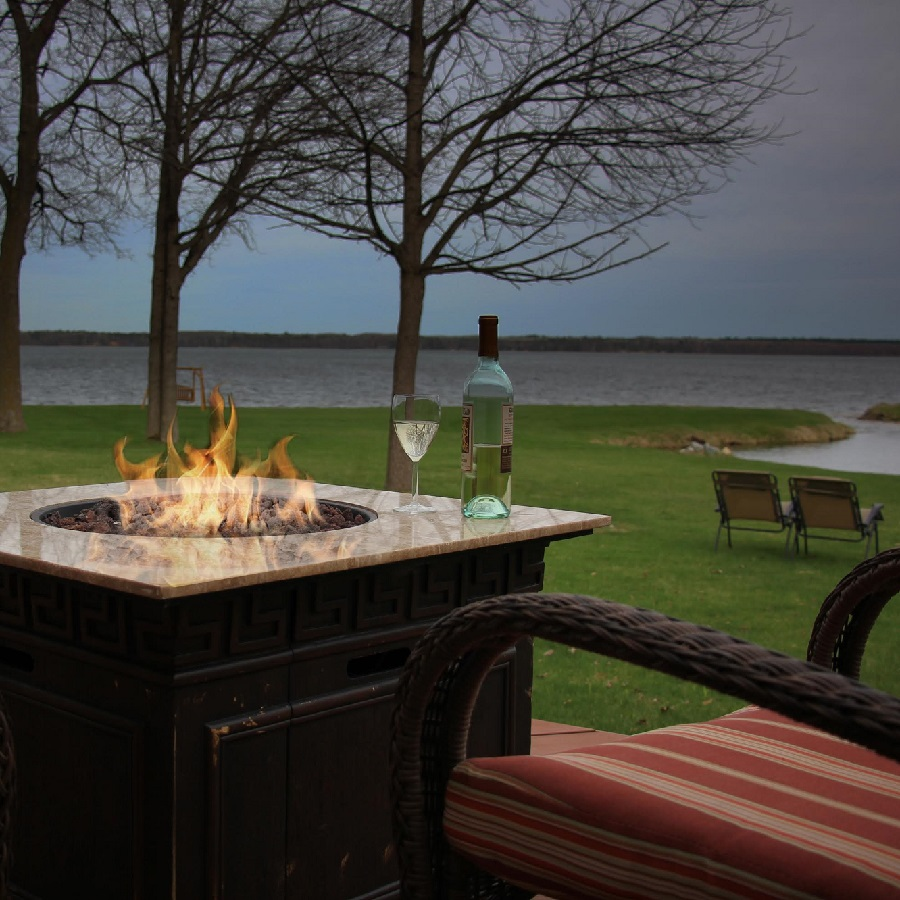 Relax on the deck near the Leech Lake B & B fire pit with a lake view.