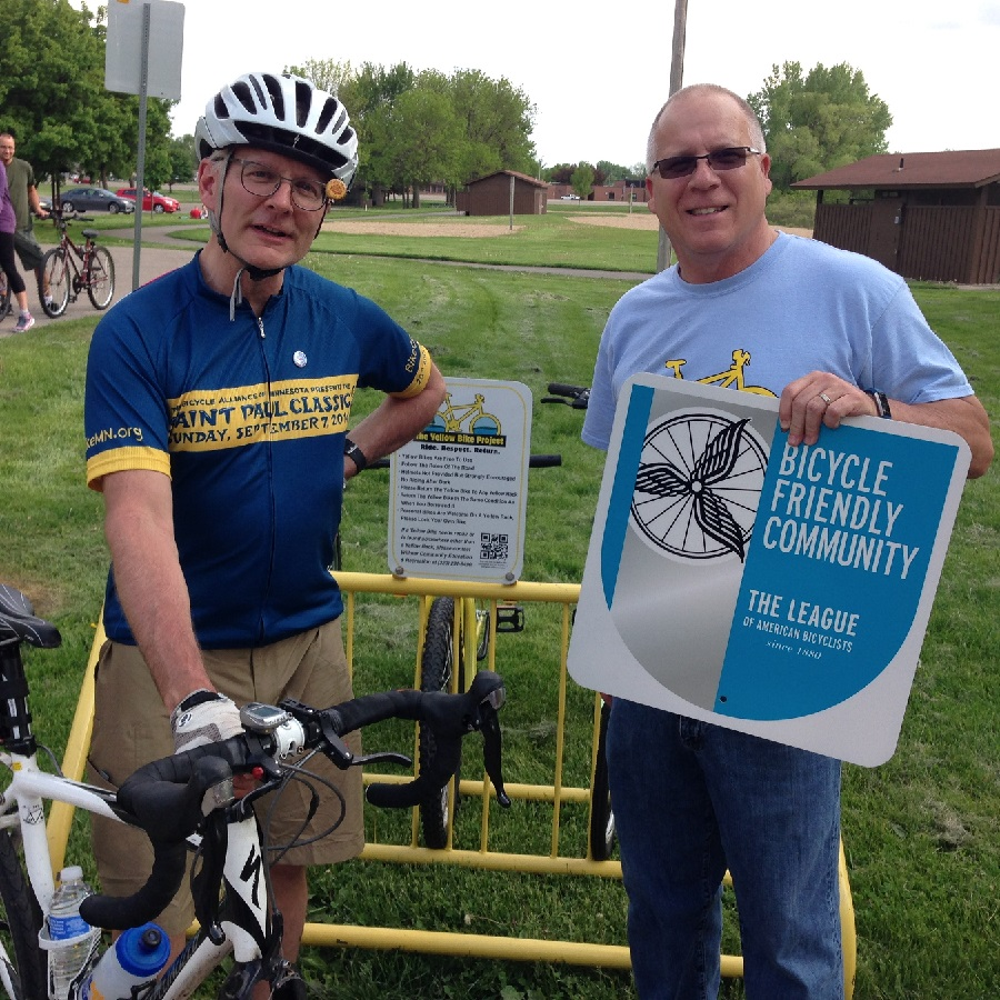 Here Dorian Grilley, Director of the Bicycle Alliance of Minnesota and Steve Brisendine, Director of Community Education and Recreation for the City of Willmar celebrate Willmar being a bike friendly city by the League of American Bicyclists.