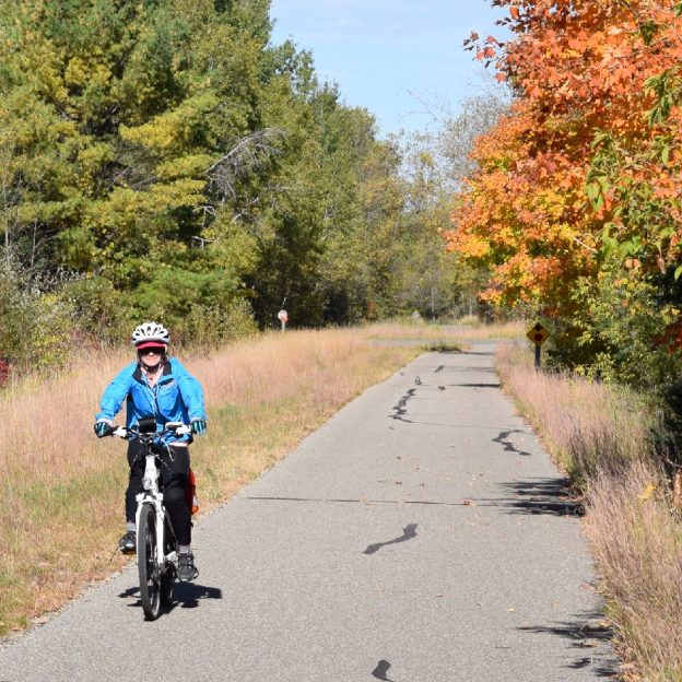 Here this cyclist is enjoying Minnesota's peak riding time on the Paul Bunyan Trail.