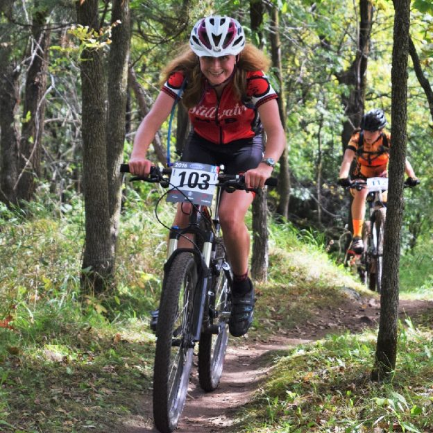 Miles of Smiles Sunday on the mountain biking Jail Trail highlights the fun of cycling. Here in this photo, a team member of Stillwater High School is having fun on the mountain bike course on the east side of St Cloud, Minnesota.