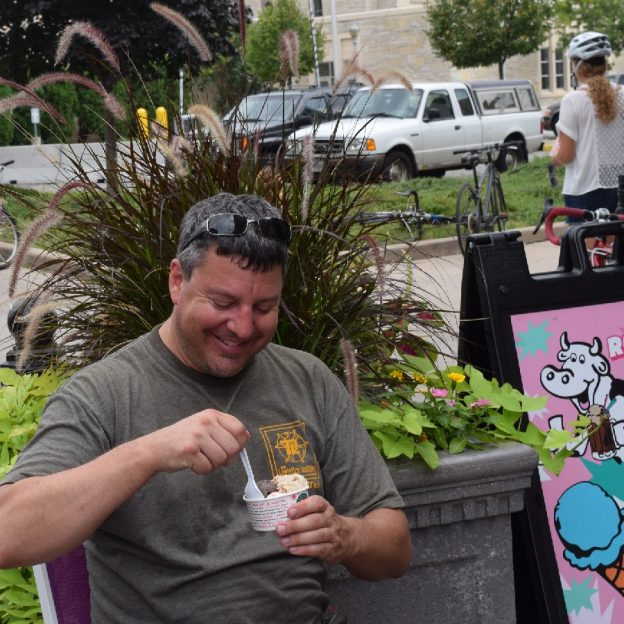 It's Ice Cream Smiles Friday and this week we found our Pic of the Week taking a break from his ride to enjoy a cool treat the La Crosse Bike Festival.