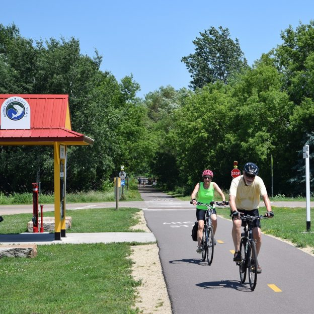 Another beautiful day on the Browns Creek Trail. Here in this photo a couple of cyclist enjoy a gradu;le trail ride up out of stillwater, MN to connect to the Gateway Trail to easily make it to St. Paul.
