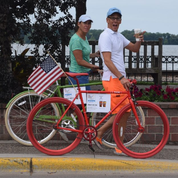 The American Dream, Beer and Bikes! Here are a couple cyclist living the dream. Promoting free beer with a Latte.