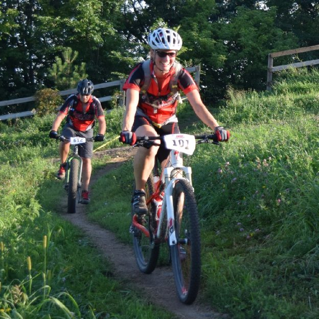 Summer mountain biking fun on the Hill at the Penn Cycle's Thursday Night at the Races on Buck Hill. Photo taken near Lakeville, MN on August 4, 20 16.