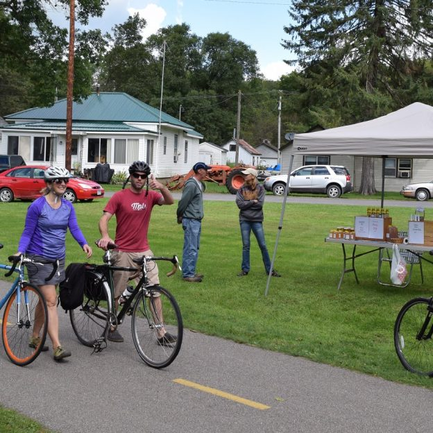 Sunday's Miles of Bike Smiles shows a couple walking their bikes along the Root River Taste of the Trail, in Whalan.
