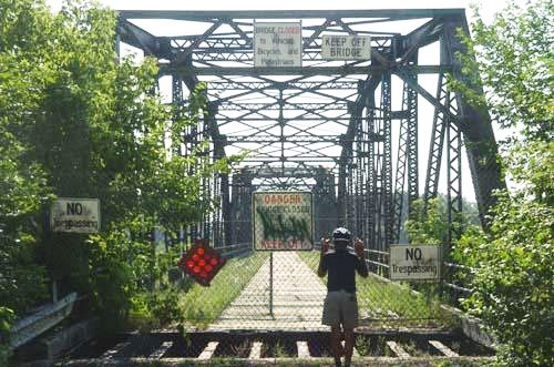 Here a cyclist looks at the Old Cedar Bridge, a great place to cross the MN River, before 2002.