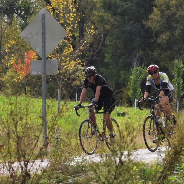Here these cyclists are enjoying Minnesota's peak riding time on the Red Jacket Trail, near Mankato.