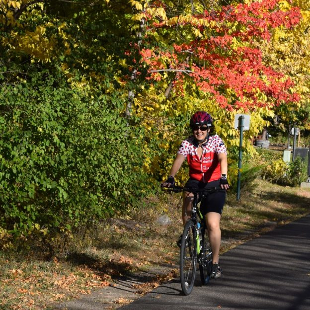 Here this cyclist is enjoying Minnesota's peak riding time on the Minneapolis Greenway Trail.