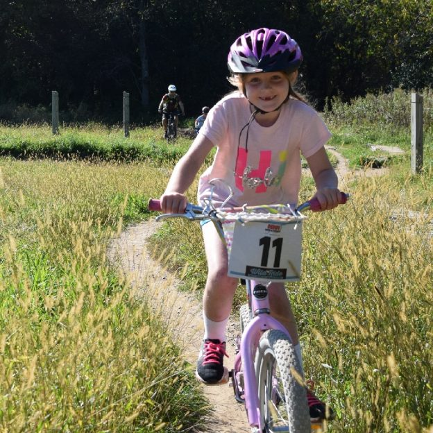 Photo shows a young cyclist having the time of her life at the Wild Ride Mountain Bike Festival, Lebanon Hills Park,that took place yesterday.