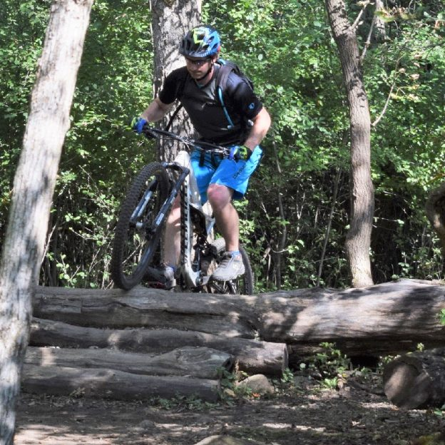 With determination, this motivation Monday cyclist demonstrates his skill in successfully climbing a log ramp in Lebanon Hills Park, near Lakeville, MN.