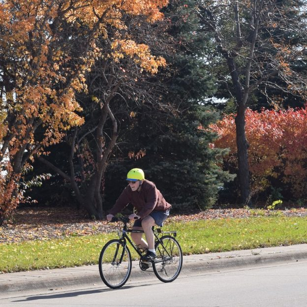 Still finding the fall color in the Twin Cities. Here in this photo a cyclist is on a bike route headed for the Old Cedar Bridge recently restored in Bloomington, MN.