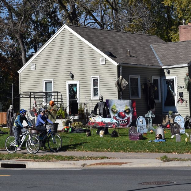 Another colorful day to get on your bike and explore the neighborhood, searching for homes with Halloween Decorations spread in the yard to spook those who pass by.