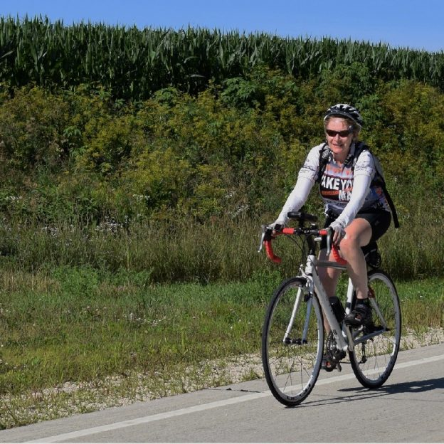 Here in this photo, we found a cyclist enjoying some summer touring fun in the Bluff Country of Southeast Minnesota near the Root River Valley.