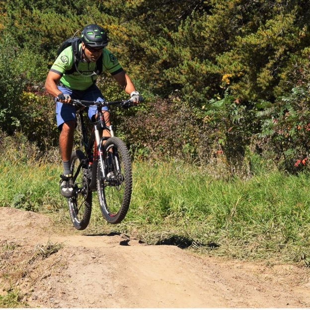 This cyclist keeps a steady eye ahead as he encounters an undulating stretch in the mountain bike trail.