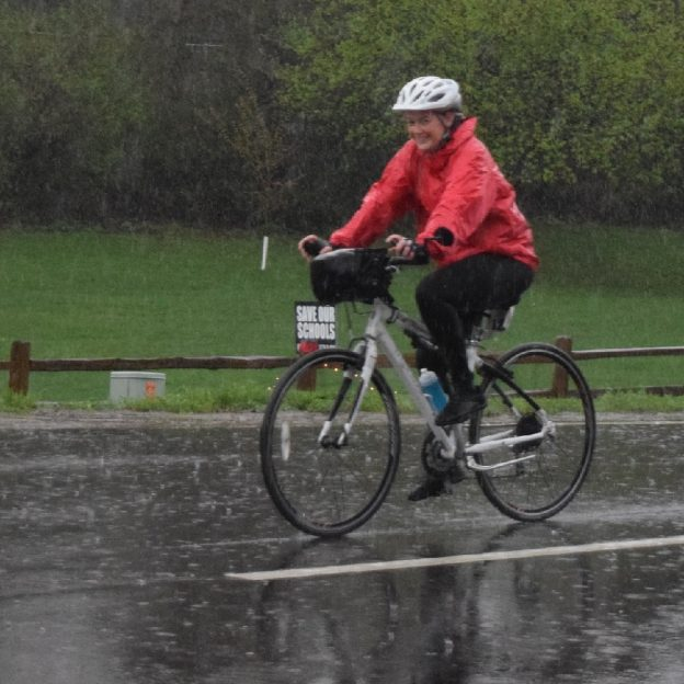 With a smile, rain or shine, this cyclist is going to get her 30 Days of Biking in regardless.