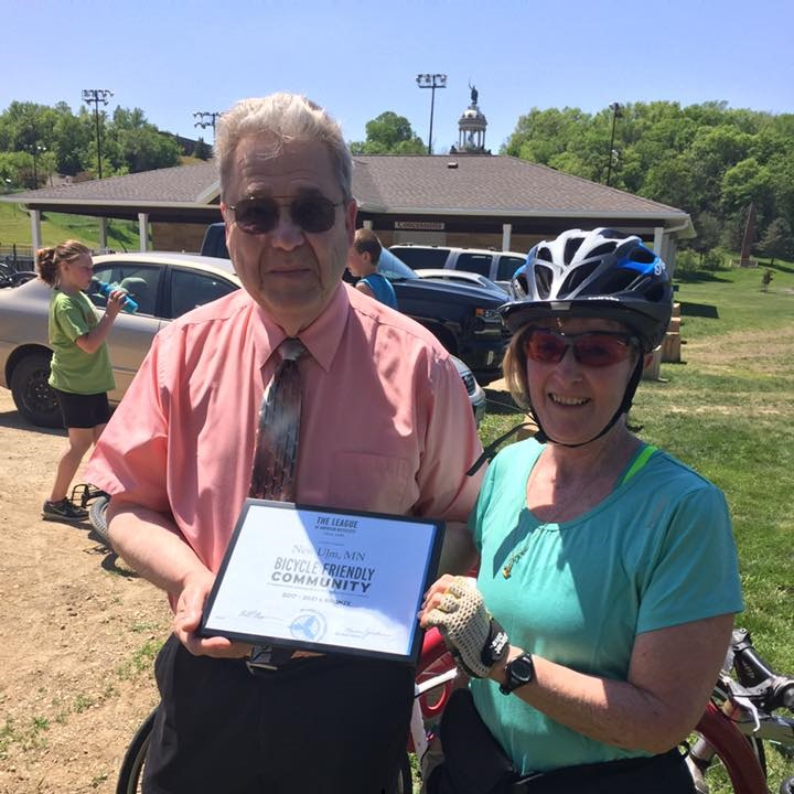 Cindy Winters from Hearts Beat Back Project is shown here presenting the LAB Bicycle Friendly Community plaque to New Ulm Mayor Bob Beussman.