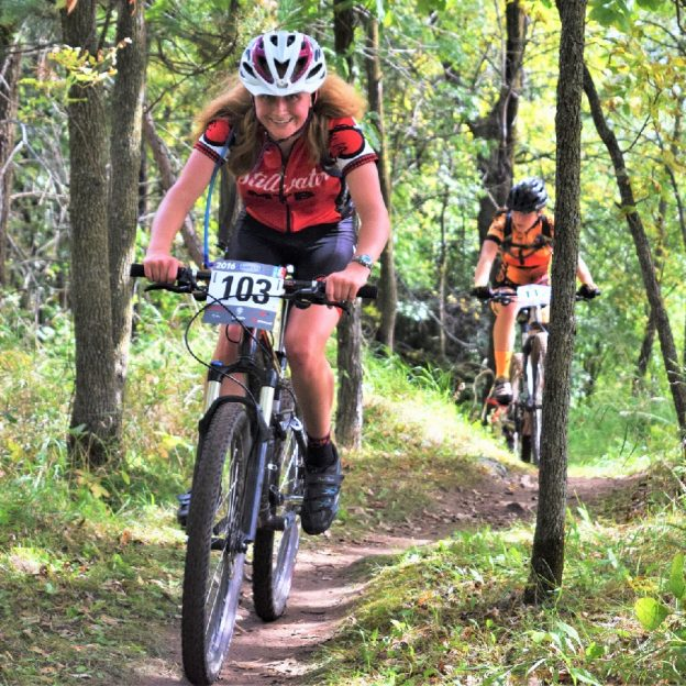 Students compete on the Jail Trail, Near St Cloud MN, on a Minnesota High School Bicycle League, a part of the National Interscholastic Cycling Association.