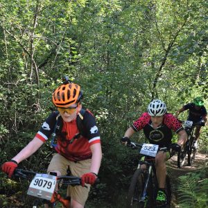 Here in this bike pic, a pack of Crank Sisters from the Minnesota High School Cycling League testing their mountain bike skills on the Jail Trail, near St Cloud, MN.