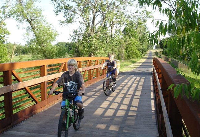 Riding over one of the wooden bridges crossing the Rice Creek Trail