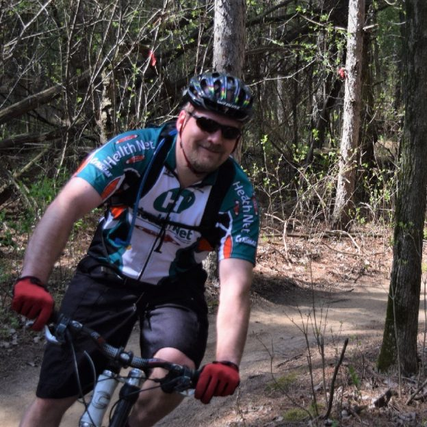 This mountain biker finds a dry trail to enjoy a day of fun on one of Minnesota's many challenging and picturesque scenic wooded areas in the state.