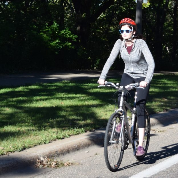 We caught this cyclist as she was riding the Mississippi River Trail in St Cloud, MN.