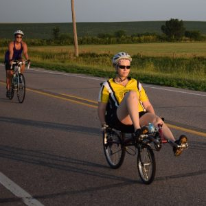 Here are some bicycle riders having fun, pedaling into the morning sun on a picture perfect day riding out of Orange City, IA, on RAGBRAI 2017.