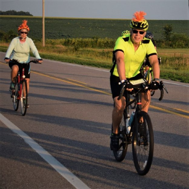 These RAGBRAI cyclist are wearing safe visible clothing with an extra dab of orange.