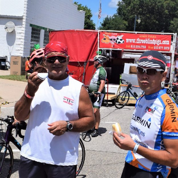 Its Ice Cream Smiles Sunday and here are some cyclist after a hard day on RAGBRAI, in late July, enjoy a ice cream sandwich from a mobile sweet shop.
