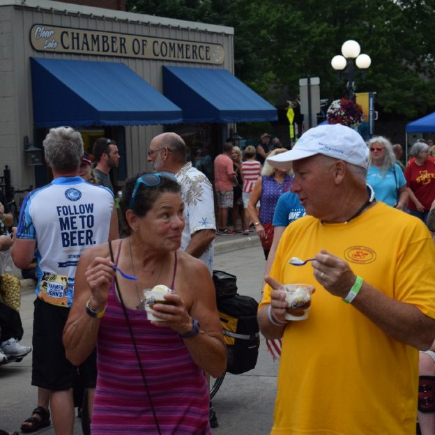 Its Ice Cream Smiles Sunday on RAGBRAI 2017 and these two cyclists stopping in Clear Lake, IA. enjoy a cool treat along the way.