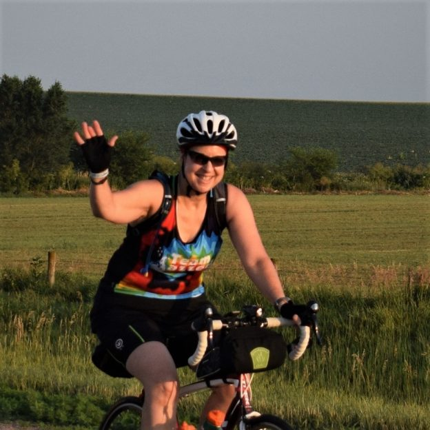 Here is another bicycle rider having fun, pedaling into the morning sun on a picture perfect day riding out of Newton, IA, on RAGBRAI 2018.