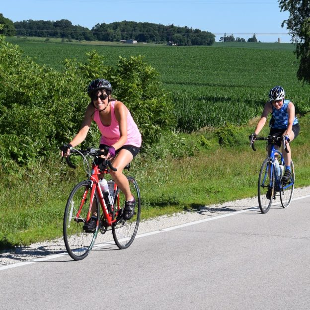 Here are a couple biker chicks having fun, pedaling into the Monday morning sun on a picture perfect day riding out of Preston, MN.