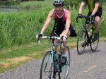 Many Cyclists riding around Albert Lea Lake enjoyable