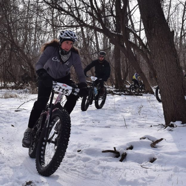 With below normal temps snow is sticking throughout the upper half of Minnesota making it perfect for some fat bike fun as this biker chick demonstrates.