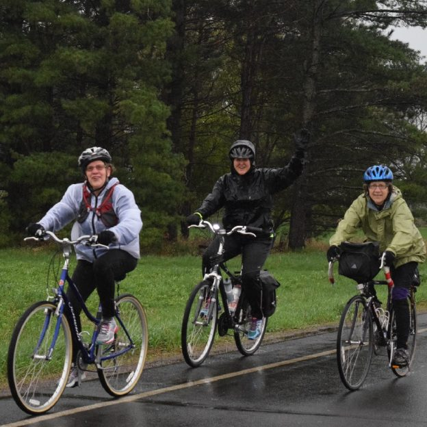 A little damp weather cycling wont stop these biker chicks from having a good time.