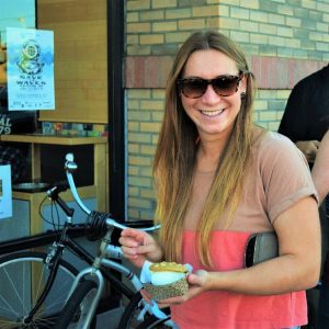 Its Ice Cream Smiles Sunday here in San Diego and this young lady stops along the bike route to enjoy a creamy cool ice cream sandwich.