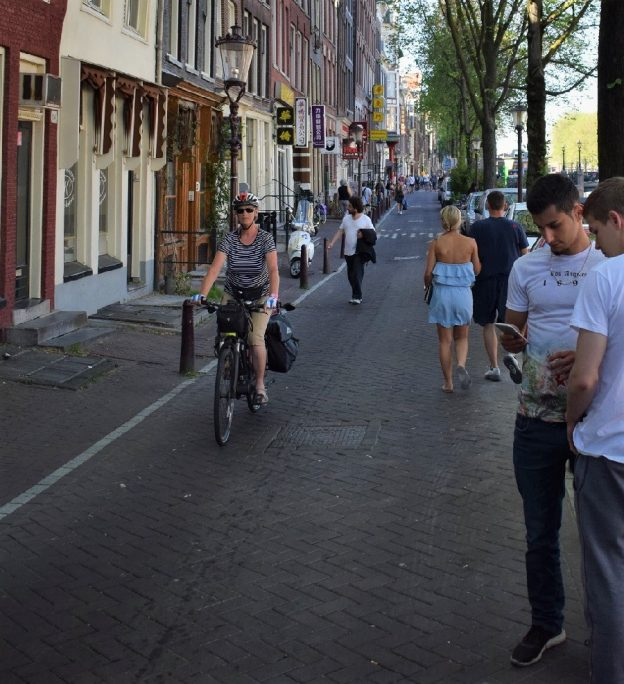 Pedaling along the bike lane in Amsterdam