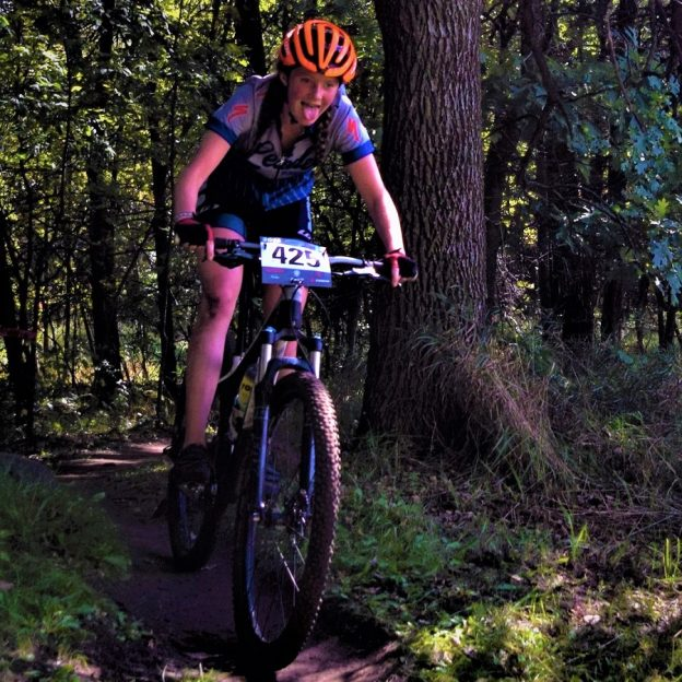 This Friday Pic we found this young lady competing in a tough MN H. S. Cycling League MTN bike competition, on the the Jail Trail in St, Cloud, this fall.