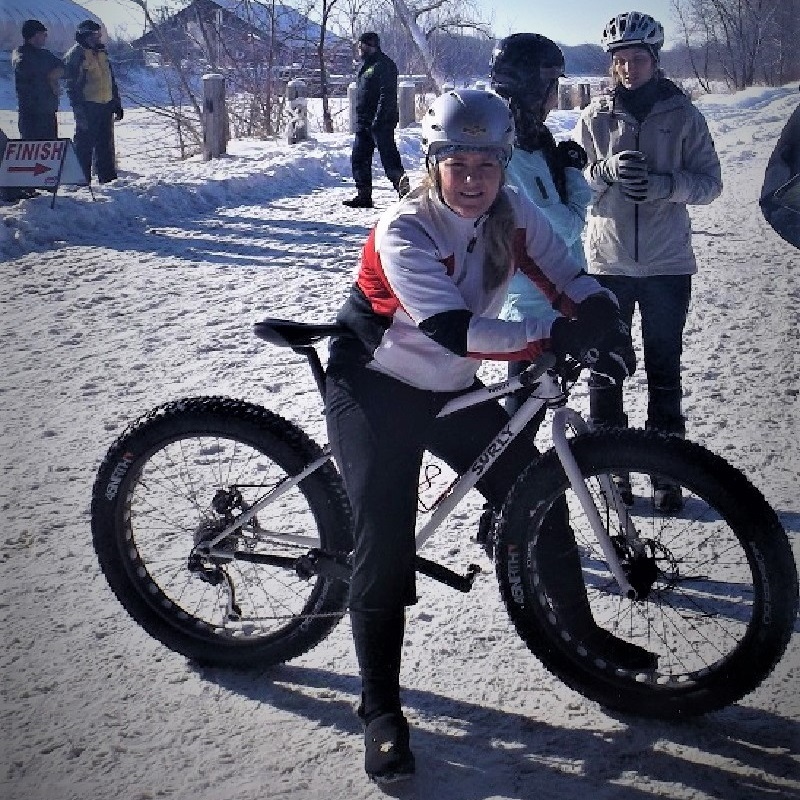 Winter fat bike fun is back in the upper Midwest as this biker takes a break for this photo opp.