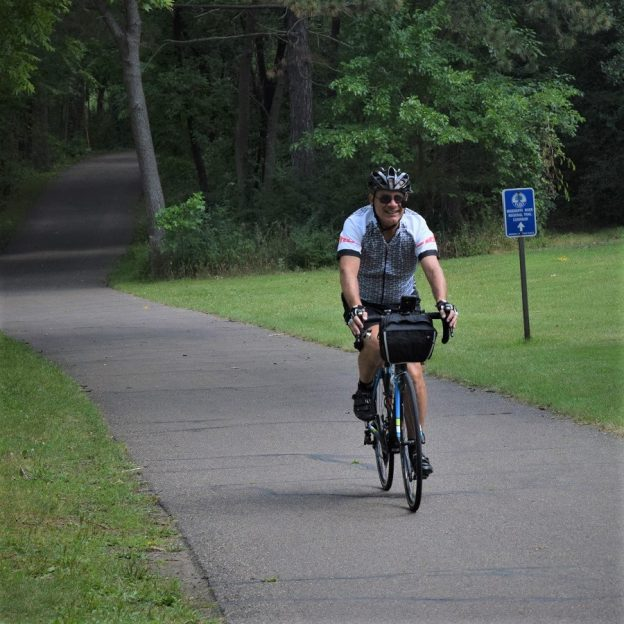 Here is a biker dude having fun, riding into the Monday morning sun on the Mississippi River Trail Corridor that runs through the Twin Cities Gateway community of Fridley, MN.