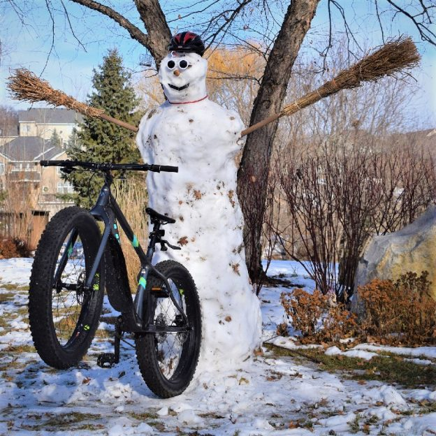 A frosty fun bike pic to remember! Here we found Frosty excited to about wheelie Wednesday and to hear that more snow is on the way.