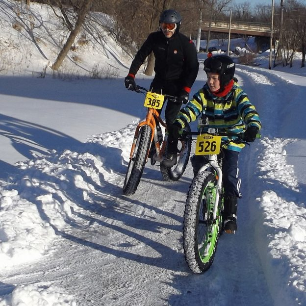 Happy New Years as you begin 2018, we hope its you best year yet! Start the year off right with a resolution to do more biking like this father/son duo, in the photo at last years Arctic Fever Fat Tire Race, in Excelsior, MN.