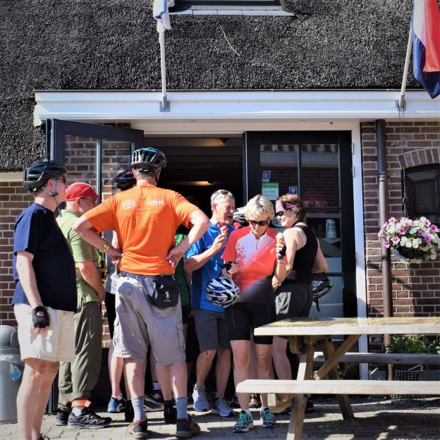 Its ice cream smiles Sunday around the world and here in the Netherlands and these Minnesota cyclists are enjoying a cool treat before they continue their ride along the canals from Amsterdam to Bruges.