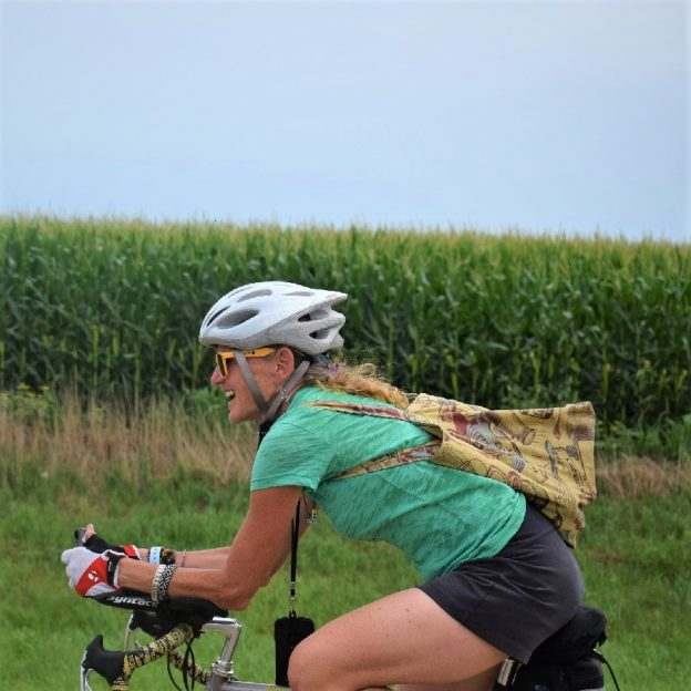 Fond summer memories on RAGBRAI, of this biker chick, in the saddle, enjoy the country fresh air and lush corn fields while riding across Iowa.
