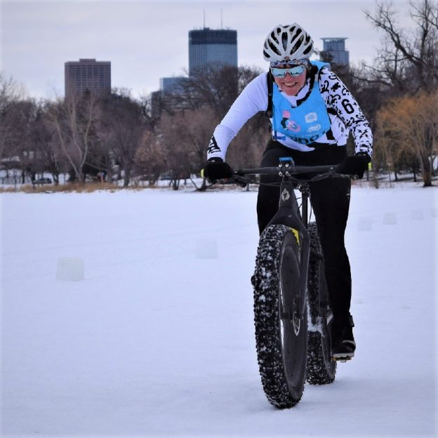 Here in today's bike pic, this bold north biker chick is having fun riding into the Monday morning sun, across Lake Isles in Minneapolis, before the next snow front passes through.