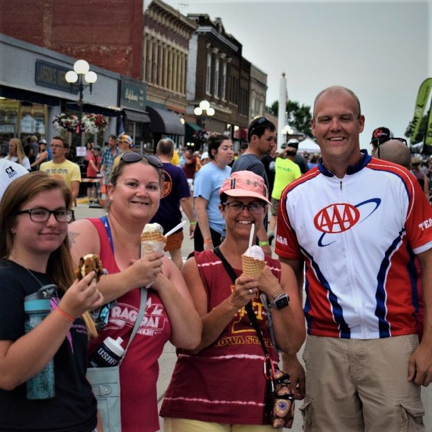 Sharing an ice cream treats in front of the AAA The Auto Club Group's booth, on RAGBRAI